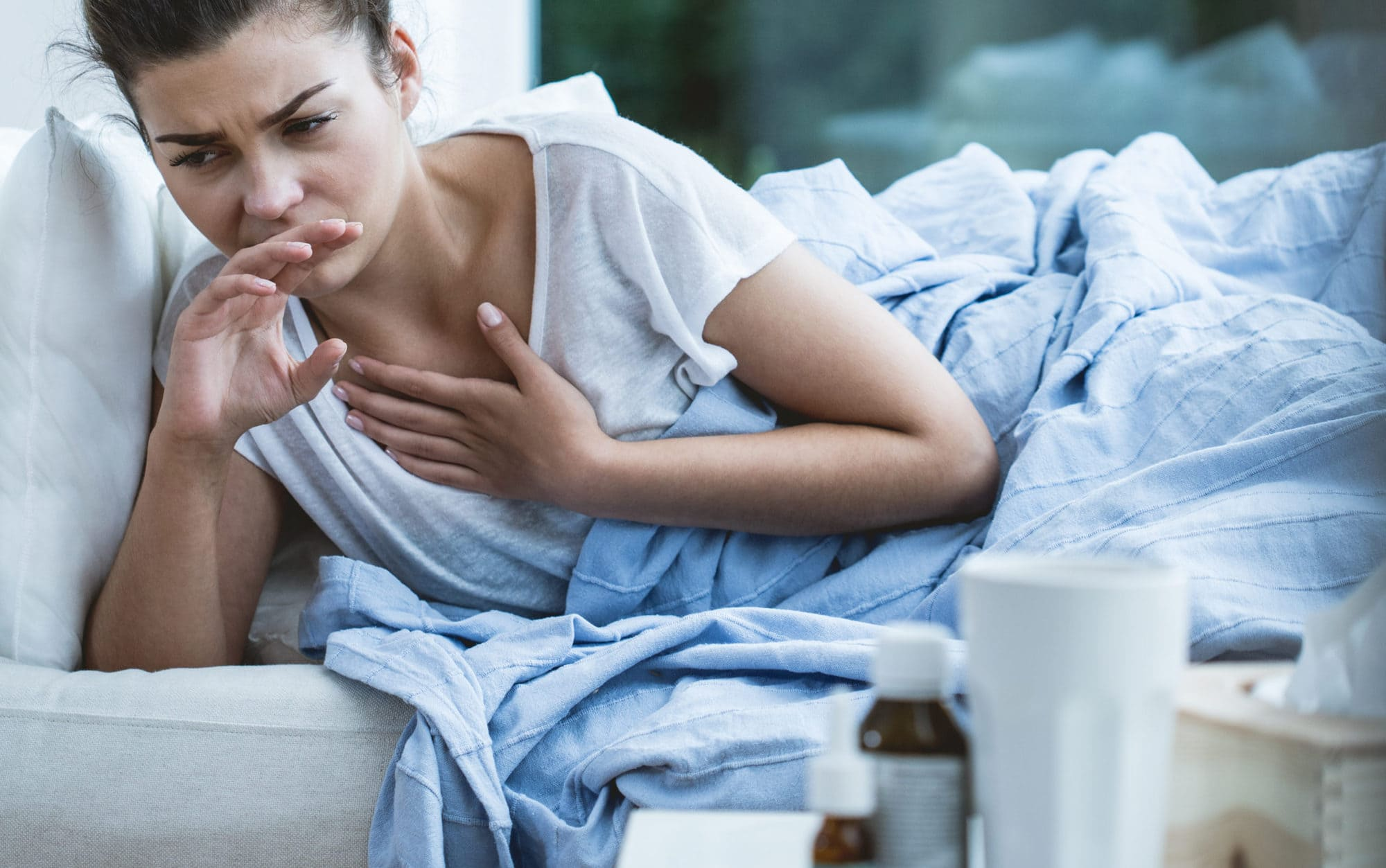 Picture of sick woman with cough and virus infection